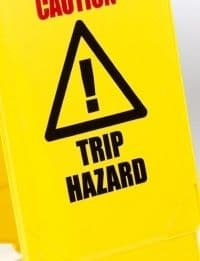 caution trip hazard A-frame sign - yellow with black/red signage