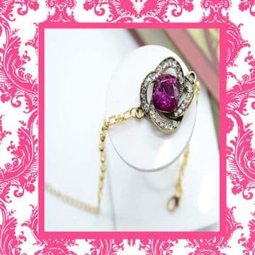 A160040 - Gold metal with crystal embellished fuchsia stone charm bracelet