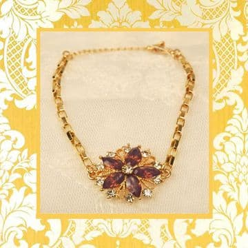 A160055 gold crystal embellished purple stone charm bracelet