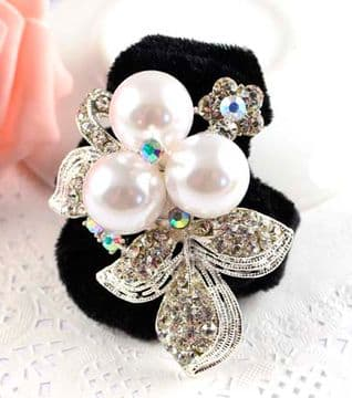 HR0030 - Black scrunchie decorated with a sparkling silver colourful sequin and peals flower