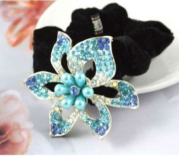 HSO030020 -  Black scrunchie decorated with a sparkling silver and blue sequin flower
