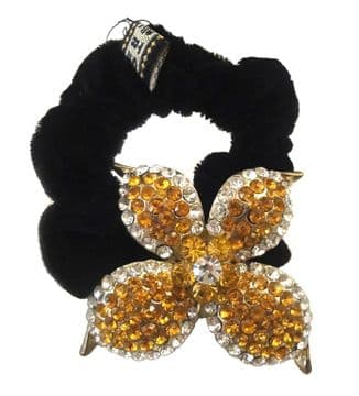 HSO030070 - Black scrunchie decorated with a sparkling yellow gold and  silver colourful sequin flower