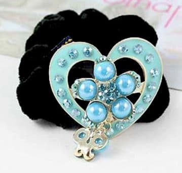 HSO030130 - Black scrunchie decorated with a sparkling silver and blue sequin heart