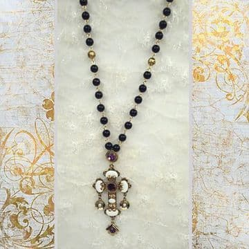 J0100277 A stunning sparkling black beads chain with a beautiful embroidery gold coloured cross meta