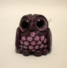 Owl with pink floral chest.